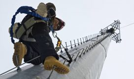Cell Tower Technician Climbing Pole
